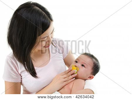 Asian mother trying to calm her crying baby boy isolated on white background