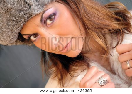 fashion portrait of a woman with brown eyes and brown hair