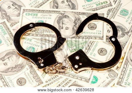 The handcuffs are on the chaotic dispersal of U.S. dollar banknotes