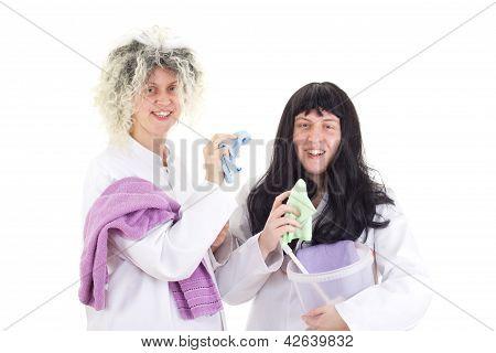 Female Cleaners In White Work Coats