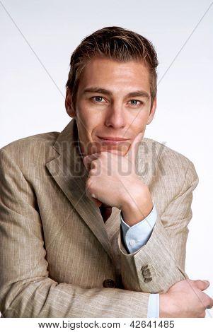 Optimistic young businessman portrait.