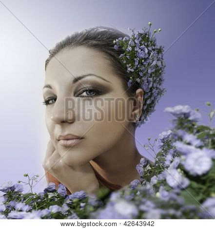 Beautiful Woman With Blue Eyes In Blue Garden
