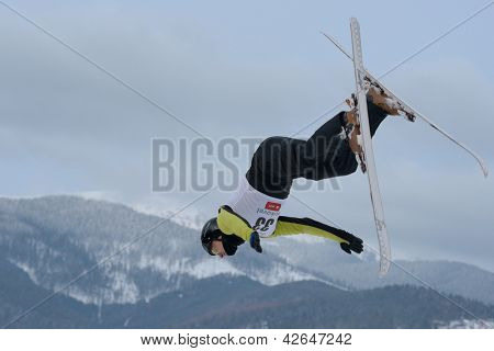 BUKOVEL, UKRAINE - FEBRUARY 23: Sergii Lysianskyi, Ukraine performs aerial skiing during Freestyle Ski World Cup in Bukovel, Ukraine on February 23, 2013.
