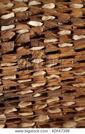 threshing board for wheat of aged wood and stones texture vintage pattern