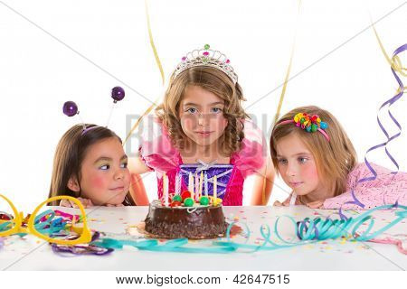 children kid girls birthday party looking excited chocolate candles cake