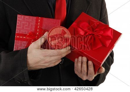 Man generous gentleman is holding red gifts