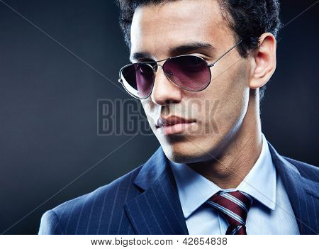 Portrait of calm man in sunglasses posing for camera
