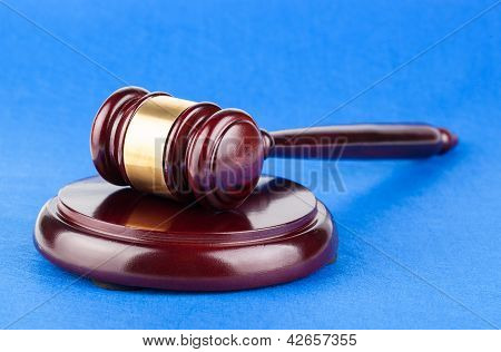 Wooden Judges Gavel On Blue Table