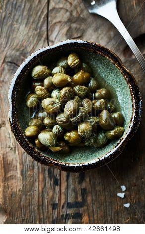 Pickled capers in a ceramic dish