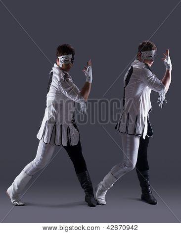 Attractive men in masquerade costumes