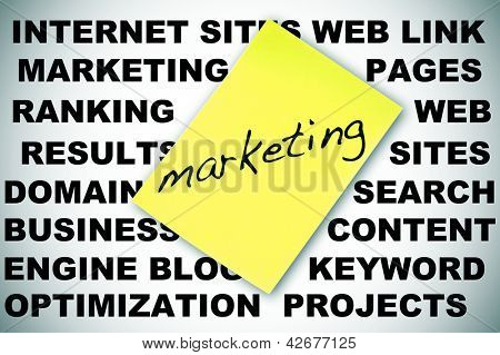 word MARKETING written in a sticky note and concepts about social engine optimization and internet subjects