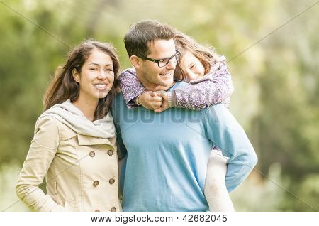 Happy family of three having fun outdoor.