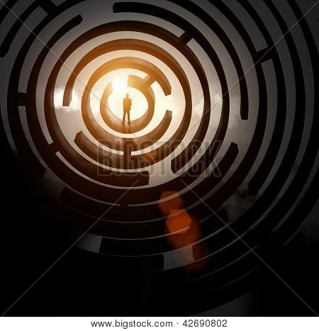 Silhouette of businessman standing in maze sun above