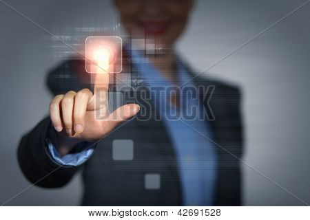Business woman touching virtual display. Business and technology concept