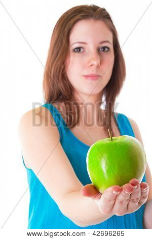 Young woman giving healthy green apple