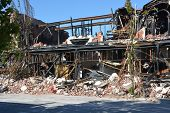 stock photo of mckenzie  - The remains of the MzKenzie & Willis building in High Street after a series of devastating earthquakes and a recent fire in Christchurch New Zealand.