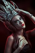 stock photo of evil queen  - Elegant queen female face with red lips and black eye makeup - JPG