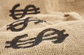 foto of sack dollar  - Burlap sacks with dollar sign - JPG