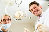 image of pov  - Scary dentist and assistant at a treatment - JPG