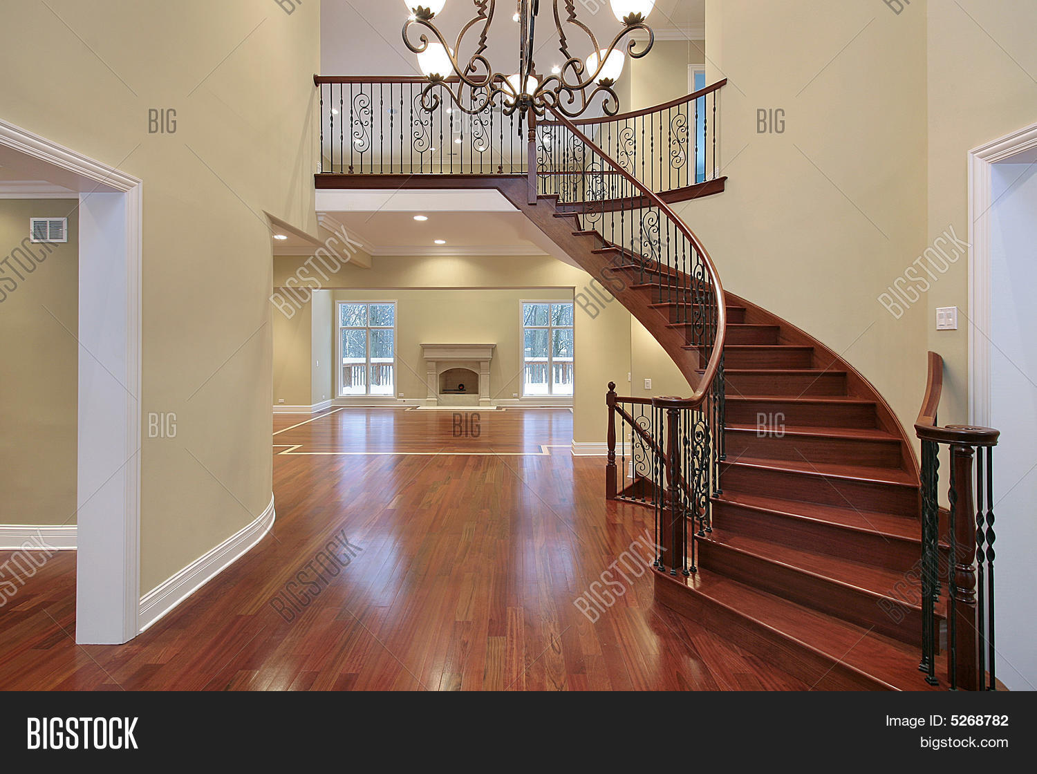 Foyer With Balcony And Curved Staircase Stock Photo Stock Images