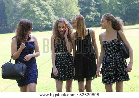 Teenage Girls Walking Through The Park