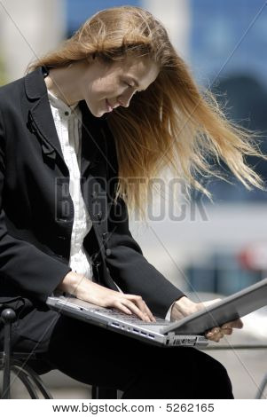 Young Undergraduate With Laptop