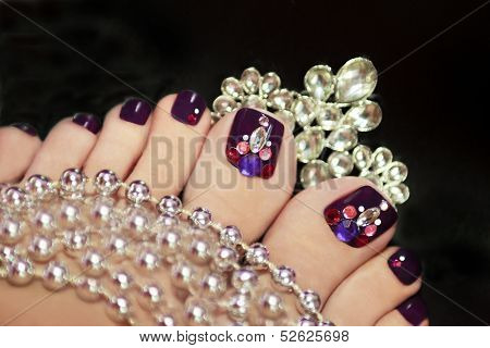 Holiday elegant purple pedicure.