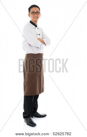 Full body portrait of confident Asian chef arms crossed, smiling and standing isolated on white background.