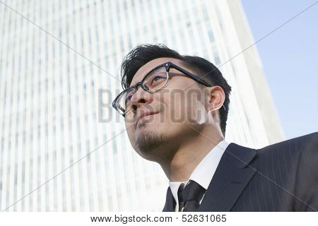 Portrait of young businessman by the world trade center in Beijing