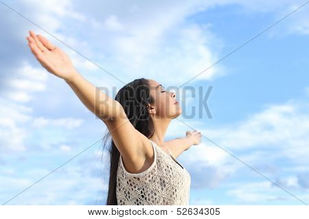 Portrait Of A Beautiful Arab Woman Breathing Fresh Air With Raised Arms