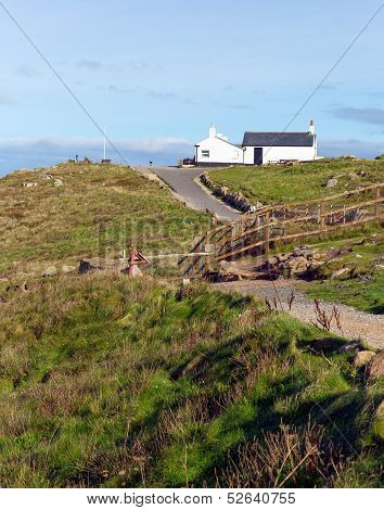 Path to first and last house Land`s End Cornwall UK the most westerly point of England