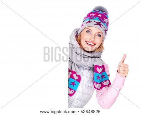 Woman In Winter Outerwear Holds The Banner With Thumbs Up Sign