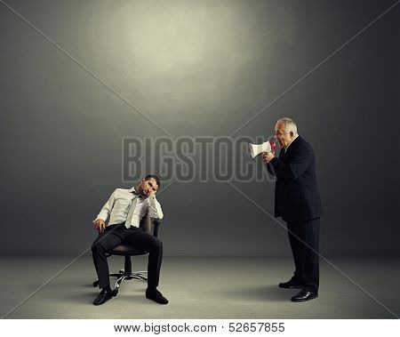 angry boss screaming at lazy worker
