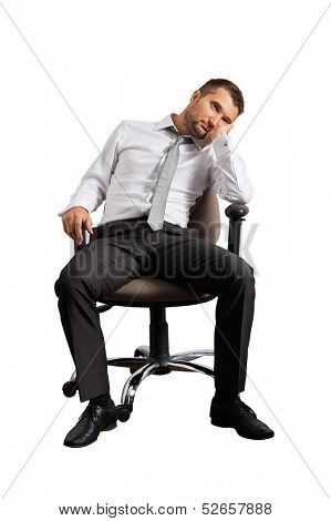 bored businessman sitting on the office chair. isolated on white background