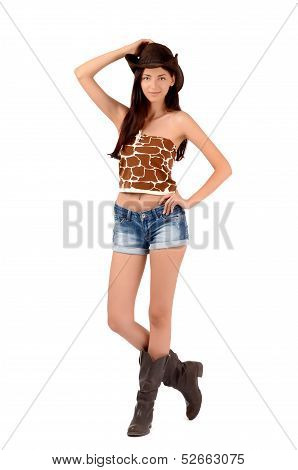 Sexy american cowgirl with shorts and boots and a cowboy hat.