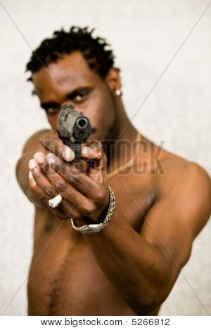 Black Man Pointing A Semi-automatic Pistol In A Threatening Way