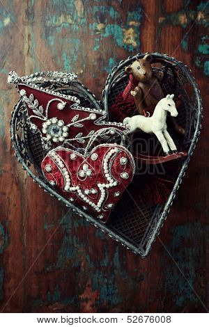 Vintage christmas decorations in a heart shaped basket