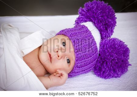 The Baby In A Violet Knitted