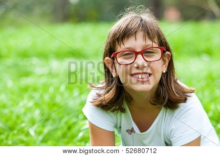 Cute Handicapped Girl In Green Field.
