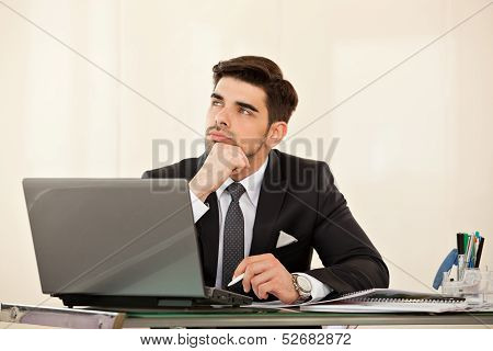 Business Man Daydreaming At His Desk
