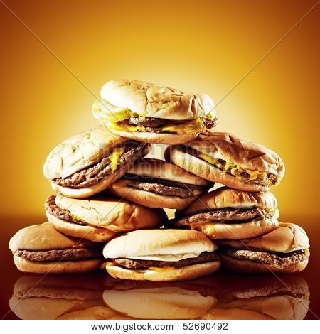 concept photo of a large pile of cheeseburgers