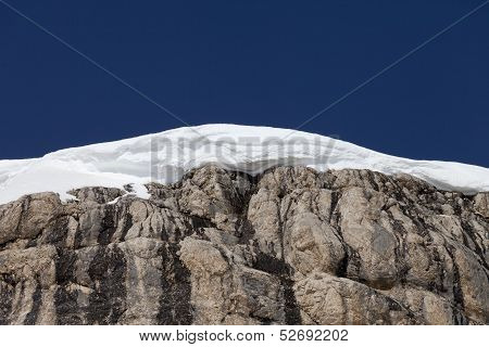 Snow Cornice And Blue Sky