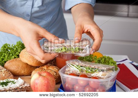 Woman Preparing Takeaway Meal