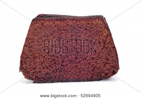 some slices of chocolate sponge cake on a white background