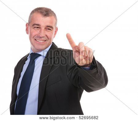 business man touching an imaginary screen with his finger and smiling. on a white background