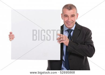 business man holding a blank pannel and smiling for the camera. on a white background