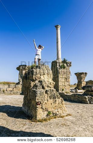 Girl Posing Amid The Ruins Of Carthage