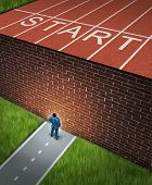 foto of track field  - New job challenges concept with a business and financial obstacles metaphor as a businessman standing in front of a large brick wall that has blocked his track and field path obstructing a journey to success - JPG