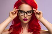 foto of redhead  - Cute young sexy redhead girl with glasses - JPG