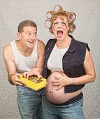 stock photo of redneck  - Sorry hillbilly man giving pregnant woman candy - JPG